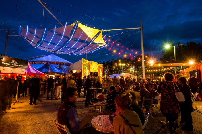 Patrons enjoying fine Tasmanian food and wine at the 2014 Spiegeltent outdoor lounge.