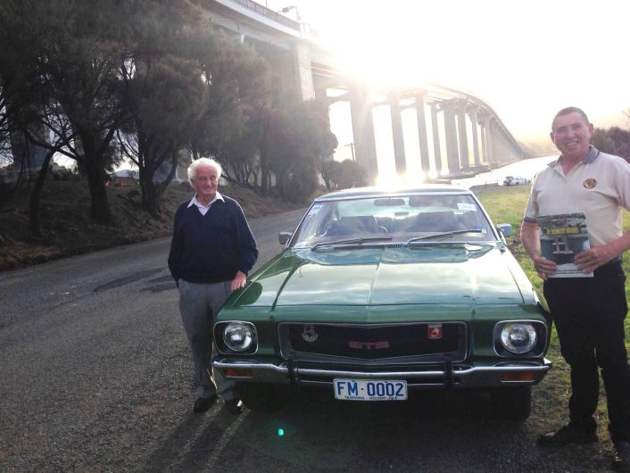 Frank Manley, with his son Shayne and Frank's iconic Monaro which ended with its wheels over the edge of the bridge in 1975